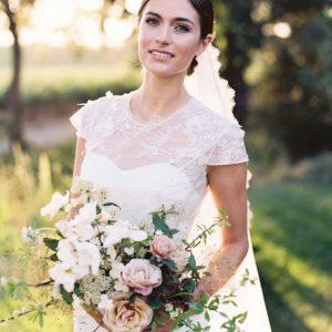 Veil updo, brunette bride, brown hair, chignon, bun.