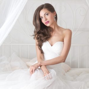 Brunette bride, brown hair waves, side part, one shoulder hairdo.